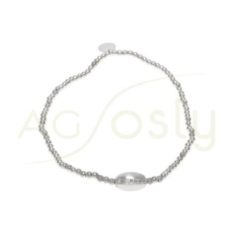 Pulsera elastica con bolas de plata rodiada y motivo de ovalina con tira de circonitas.