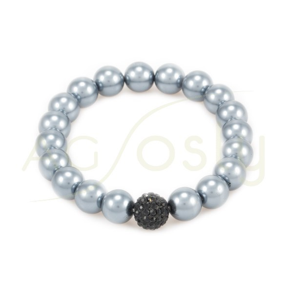 Pulsera elastica con perlas y motivo central de cristal negro.
