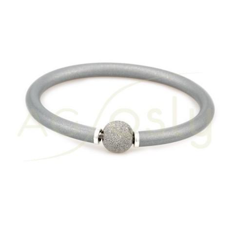Pulsera plata KARISMA alma de acero con caucho plateado chispeado y bola diamantada chapada.