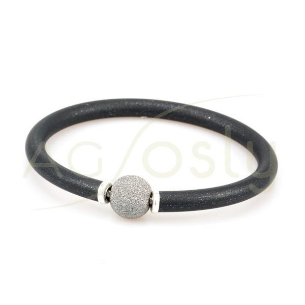 Pulsera plata KARISMA chapada alma de acero con caucho negro chispeado y bola diamantada con baño de rutenio.