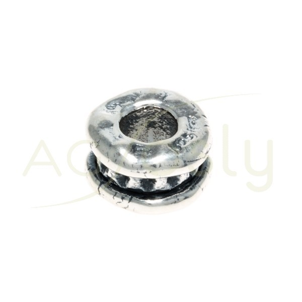 Entrepieza oval disco con textura.14mm Int.6mm