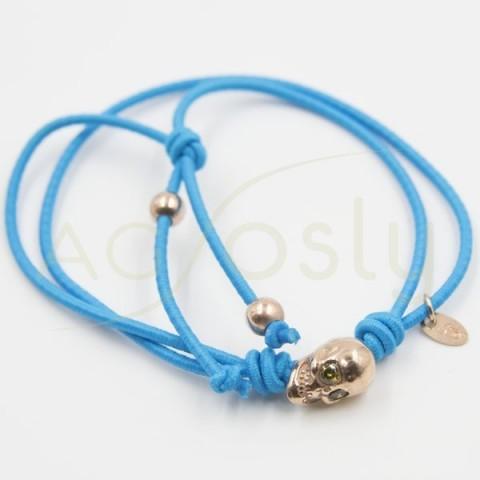 Pulsera de goma elastica azul con una calavera