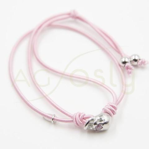 Pulsera de goma elastica rosa con una calavera