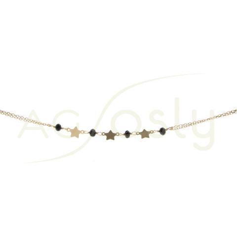 Pulsera de plata dorada con estrellas y bolitas negras